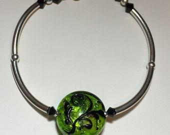 Sparkly green and black scrollwork bracelet, electric green lampwork bracelet, bright green and black bangle bracelet