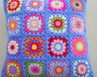 The hippie happy crochet granny square cushion cover / pillow cover in blue edging