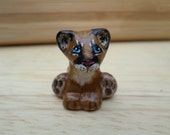 miniature mountain lion, puma, cougar,  animal totem