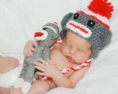 red sock monkey hat (0-3 months) and monkey doll