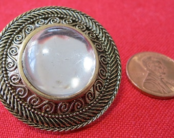 """Lovely large, 1.75"""" inch button, moon glow center, ornate gold toned metal looking plastic rim. Self shank. Coat button. CLAM15.3-3.21-10."""