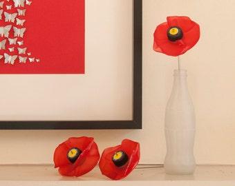 Three Plastic Bottle Poppies