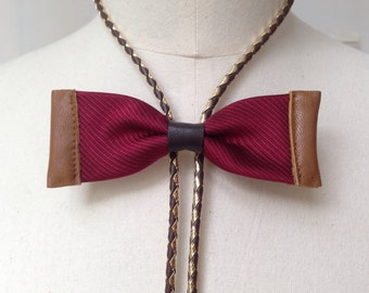 Burgundy silk bow tie with tan leather and gold/brown bolo cord (B23)