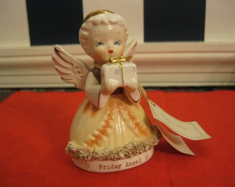 "Angel figurine of ""Fridays' Child"""