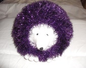 hand knitted tinsel hedgehog in King Cole tinsel wool in purple
