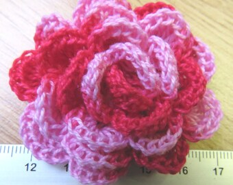 Irish crochet flower brooch in variegated red and pink