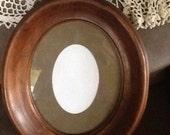 Antique oval walnut glass picture/portrait frame.