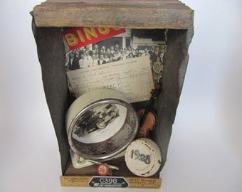 Rustic shadowbox assemblage with a 1928  school theme full of vintage items