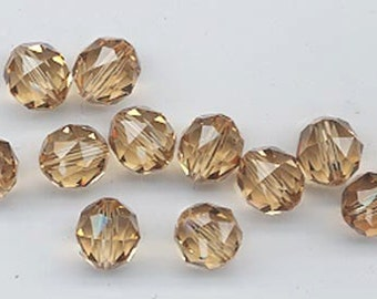 Twelve Swarovski crystals - art 5025 - 8 mm - lt colorado topaz