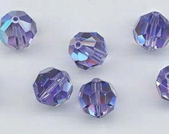 Twelve Swarovski crystals: art 5000 - 8 mm - tanzanite AB
