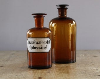 """DUTCH Antique Apothecary Bottles...set of TWO......Height 8.1/2"""" and 7"""".....Amber Pharmacy Bottles....Chemist Jars"""