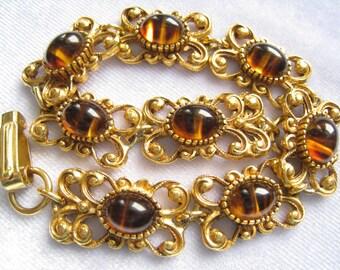SALE FLORENZA Signed Bracelet has Detailed Golden Filigree Links Set with Brown & Amber Striated Art Glass Cabs Resembling Tortoise Shell.