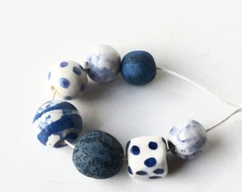 Art Beads, African beads, beads made in Africa, clay beads, blue beads, white beads, earthbutter beads, made in Africa