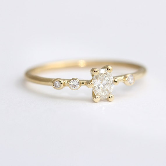 asymmetric oval engagement ring dainty by artemer