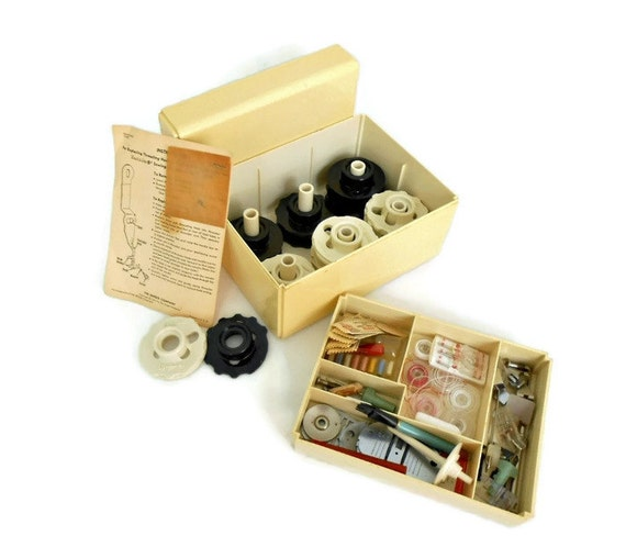 Vintage singer sewing machine kit tools and