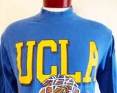 GO Bruins vintage 90's UCLA University of California Los Angeles blue long sleeve graphic t-shirt yellow orange black basketball logo medium