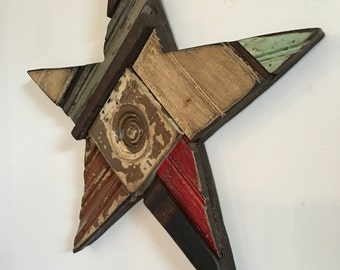 Patchwork wood not-so-perfect star designed with architectural salvage