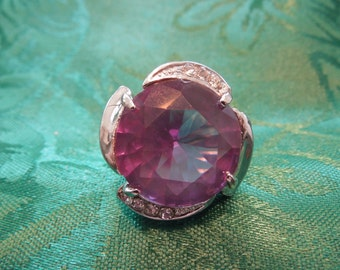 Vintage Costume Ring.  Large, Dominant Ring in Silver Tone with Large Purple Stone and Rhinestones Either Side, Size 8