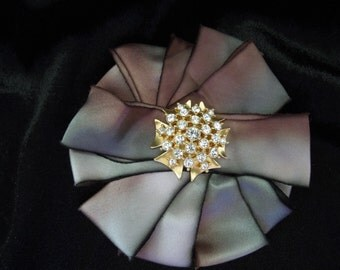 Vintage Brooch.  Silk Outer with Rhinestone Center.