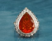 A spectacular late Art Deco fire opal and diamond ring