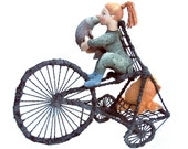 girl rides tricycle - soft sculpture