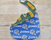 Reversible Detroit Lions and Green Bay Packers NFL Baby Bib for the baby with Both Fans in the Family For House Divided