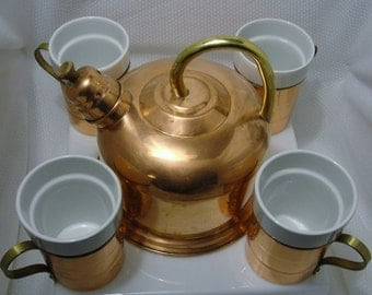 Solid Copper Whistling Tea Kettle and Set of Four Copper Mugs with Porcelain Inserts