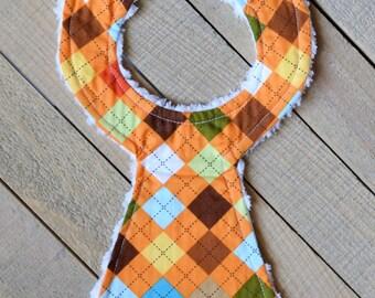 Closeout Orange Argyle Necktie Bib