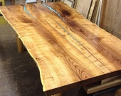 Custom live edge mesquite dining table and two benches