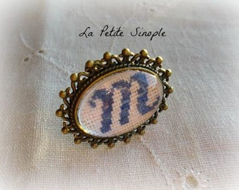 """M"" embroidered ring"