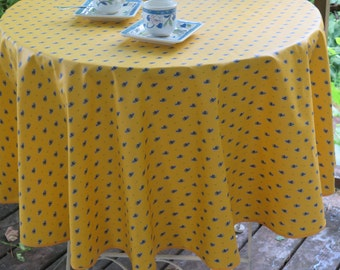 "round tablecloth.40 to 60 "" diameter .French cotton Oilcloth ,Cotton Coated .Summer. All over in yellow or blue. Choose the color!"