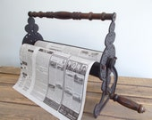 Reserved for vintageretronow  Vintage Cast Iron Newspaper Roller with Wooden Handle