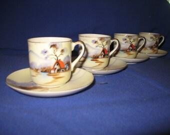 4 mini cups & saucers in porcelain. Japan