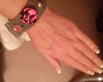 Handmade wrist cuff with pink accents