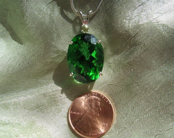Beautiful Lush Green Oval Cut Accented Moldavite.