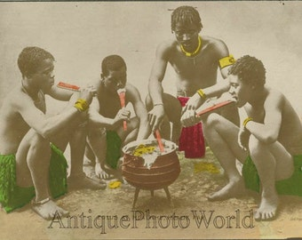 Zulu native men eating antique hand tinted photo postcard Africa