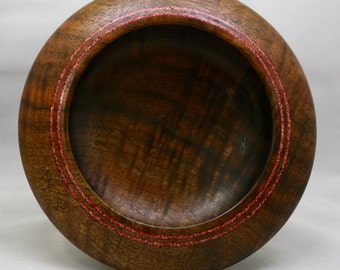 Hand turned walnut bowl with coral dust inlay