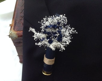 Boutonniere designed with a spent shotgun shell in navy or burgundy