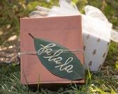 custom Christmas tags, hand lettered magnolia leaves