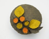 1940s-1950s inspired round olive green fascinator hat with orange and moss green felt flowers