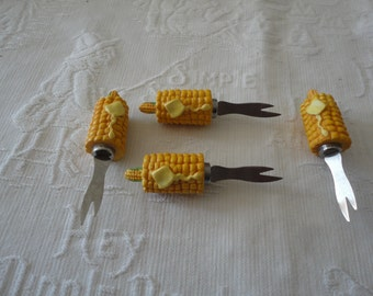 Four Corn On The Cob Holders Skewers Plastic Ears Melted Butter Pattern