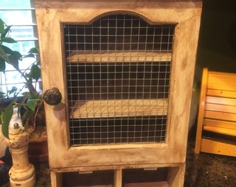 Refinished and distressed wall or counter top cabinet