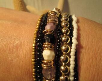 LOW PRICE!! Seven Piece beaded Bracelet -SIZE:8-stretch