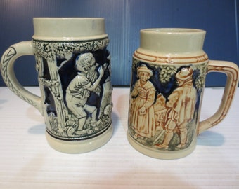 Two Vintage Beer Steins Made In Germany Gnomes And Colonial People
