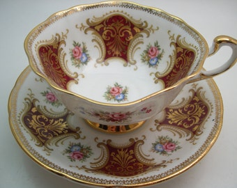 Paragon Red tea cup and saucer,  Marroon Red and Gold Tea cup And Saucer, Gold filigree and flowers,