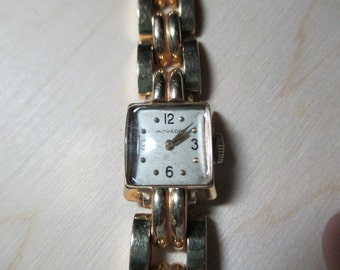 Ladies wonderful Deco Movado watch in 14kt yellow gold-nice and heavy-layaway available