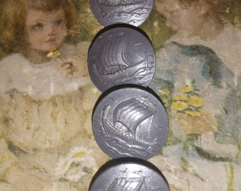 Vintage pewter norse ship buttons.