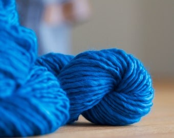 Blue handspun energised singles yarn, for textured and decorative knitting, weaving or crochet
