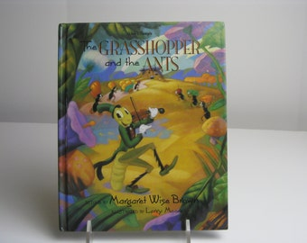 Vintage Walt Disney's The Grasshopper and the Ants book told by Margaret Wise Brown, filmic Illustrated by Larry Moore 1993
