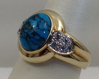 Bold turquoise and sapphire gold ring.